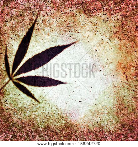Ganja leaf grunge brown orange red wall background