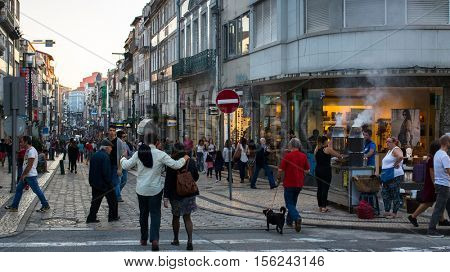 PORTO, PORTUGAL - OCT 30, 2016: Rua de Santa Catarina - it is the artery of best shopping of Downtown Porto. Length of the street 1.482 m, forbidden to car traffic and reserved only for pedestrians.