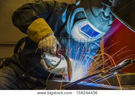 welder craftsman erecting technical steel Industrial steel welder in factory poster