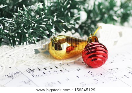white sheet of paper with musical notes printed with Christmas motifs