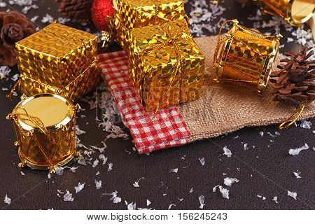 Christmas decorative gift box ball and drum on black background