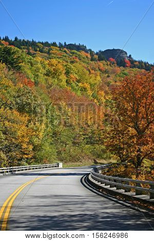 colorful autumn foliage on the hillside above the Blue Ridge Parkway in North Carolina