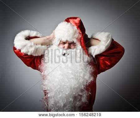 Frustrated Santa Claus. Santa Claus suffering from headache.