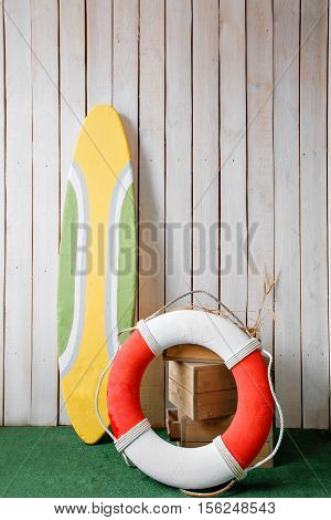 close up surfboard and lifeline on the background wooden wall.