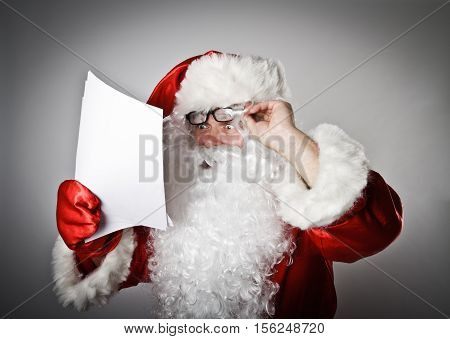 Santa Claus is reading the letters. Christmastime.