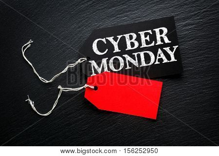 Cyber Monday Sale tags on dark background