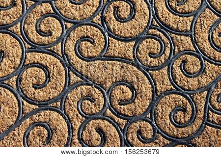 Ornate design of interconnected spiraling lines, background texture.
