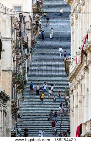 CALTAGIRONE ITALY - AUGUST 13 2016: 18th century Staircase of Santa Maria del Monte main landmark of Caltagirone Sicily. The town is famous for it's maiolica and terra-cotta wares.