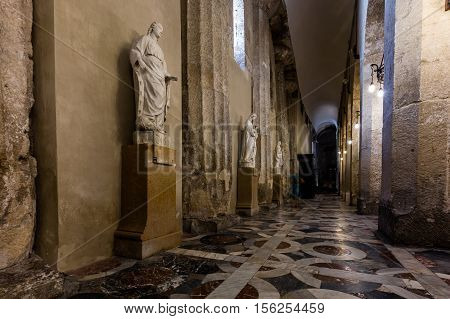 SYRACUSE ITALY - AUGUST 14 2016: The Cathedral of Syracuse a UNESCO World Heritage Site since 2005 incorporates the Doric columns of the 5th century BC Greek Temple of Athena.