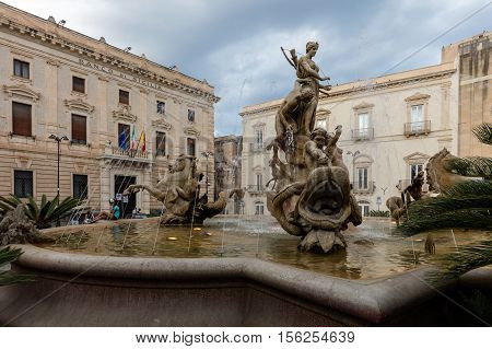 SYRACUSE ITALY - AUGUST 14 2016: Fountain of Diana in Syracuse Sicily Italy sculpted by Giulio Moschetti between 1906 and 1907.