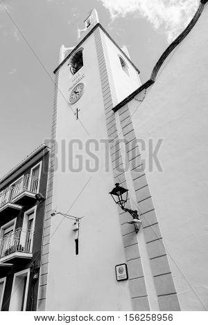 Exterior and clock tower Church Holy Virgin Parcent Spain.
