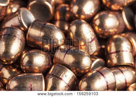 bullets on camouflage background spill out of the banks on camouflage background