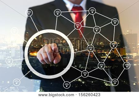 Double exposure of businessman points on screen wireless connecting concept