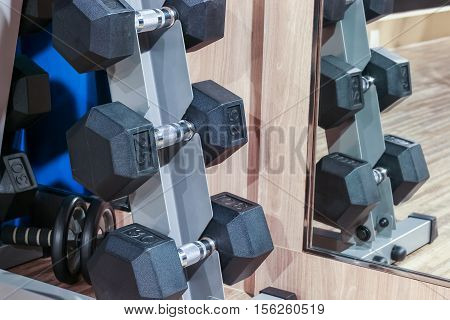 Closeup Dumbell On The Rack In Fitness Club With Mirror Reflection, Fitness Concept
