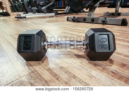 Closeup Dumbell On The Floor In Fitness Club With Mirror Reflection, Fitness Concept