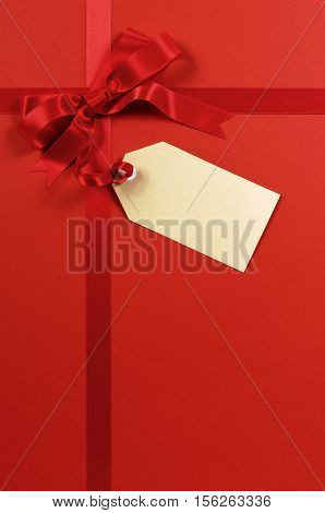 Red Gift Ribbon And Bow With Blank Tag Or Label Vertical