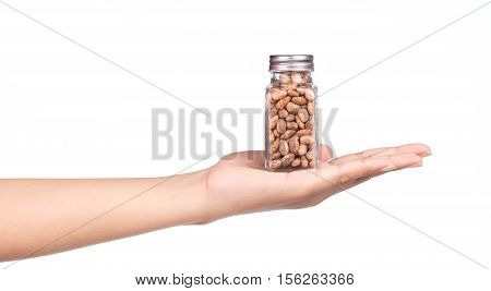 Hand Holding Bottle Of Pinto Beans Isolated On White Background