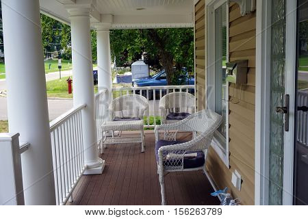 Lounge chairs on the front porch of a Victorian home on Fourth Street in Harbor Springs, Michigan.