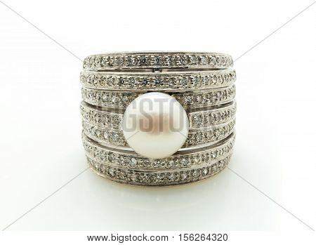 beautiful pearl ring on a white background