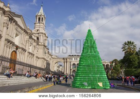 Arequipa, Peru - January 2, 2014: Christmas tree on Plaza de Armas square with Basilica Cathedral of Arequipa