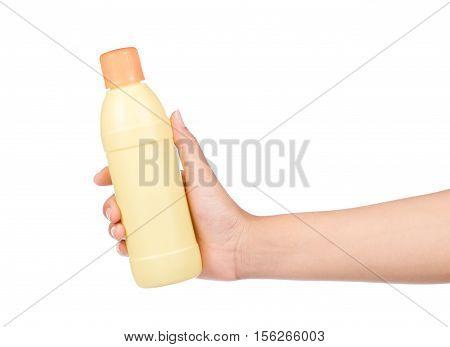 hand holding plastic bottle isolated on white background