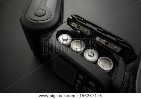 Rechargeable AA Batteries in Flash background .