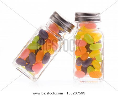 Jelly Bean Candies On Glass Bottle Isolated On White Background