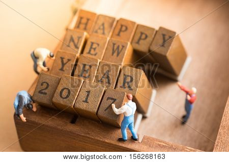 Worker with wood block with Happy New year 2017 alphabet celebration.