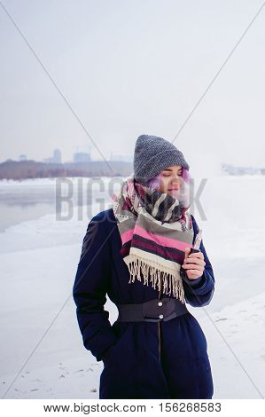 Vaping Girl. Winter Street Portrait Of A Woman Hipster, Purple-dyed Hair, A Gray Knitted Hat And Sca