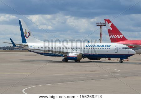 MOSCOW, RUSSIA - APRIL 15, 2015: Boeing 737-86N(onboard VQ-BIZ) Orenair (Orenburg Airlines) in the parking lot at the airport Sheremetyevo