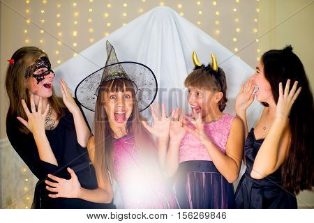 Group Of Teenagers Wearing Halloween Costumes Fear Of Ghost