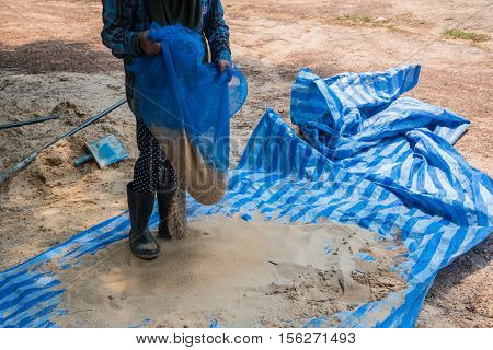 Worker working filter sand building for construction site,Worker working pan sand mixer cement for construction site