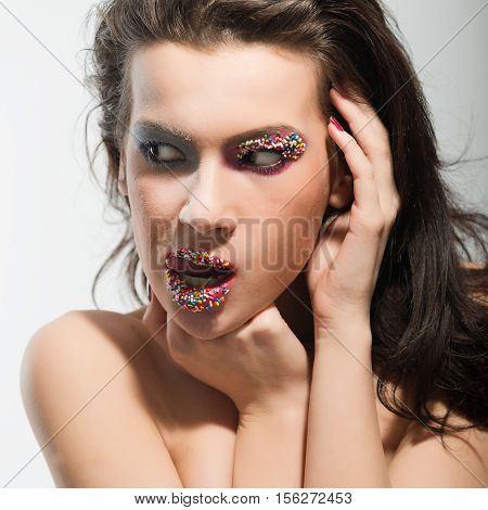 Young adult woman making grimacing with her face
