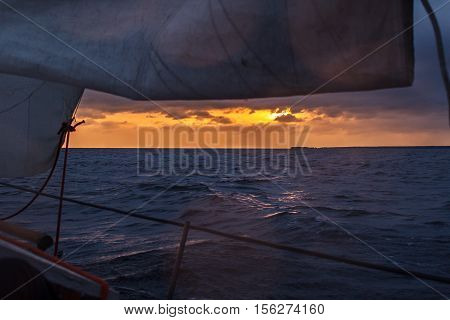 cinematic sunset in the sea, view from the sailing boat