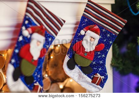 Christmas Blue Stocking Hanging From A Mantel Or Fireplace, Decorated For.