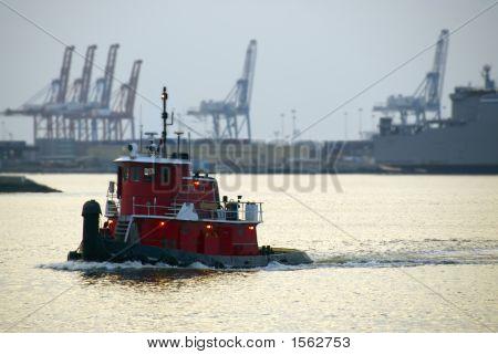 Tugboat At Sunset