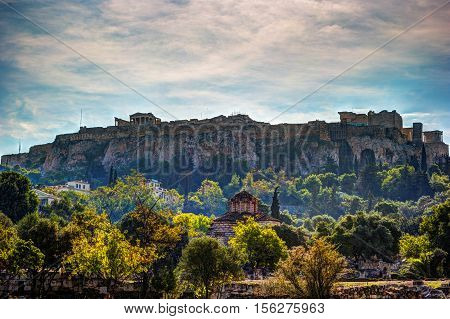 View on Acropolis from ancient agora, Athens, Greece. Beautiful landscape photography at dawn with ruins of classical greek architecture.