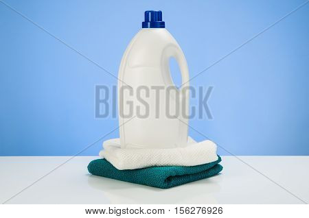 Cleaning or laundry product concept blue gradient background with accessories. Assorted products isolated on white and blue backdrop. Studio product shot for advertising, website or blog.