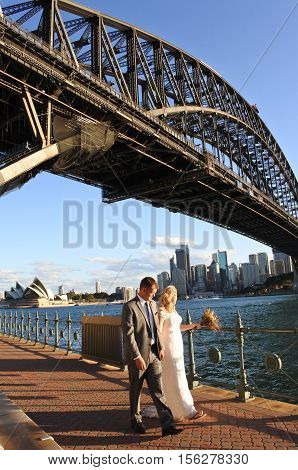 Australia Bride And Groom Walks Under Sydney Harbour Bridge Sydney New South Wales Australia