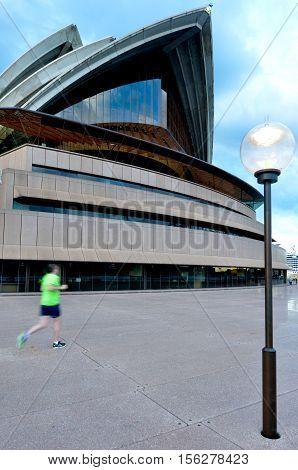 Australian Man Runs Near The Opera House In Sydney, Australia