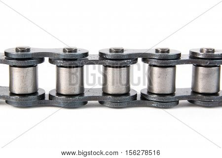 Industrial driving roller chain on white background. Machinery and Engineering.