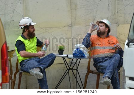 Sydney Australia - OCT 20 2016:Two Australian workers having a lunch break.Employees can't be asked to work more than 5 hours without a meal break.