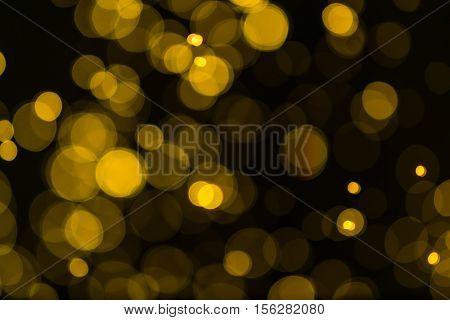 Glitter Vintage Lights Background. Dark Gold And Black. Defocused