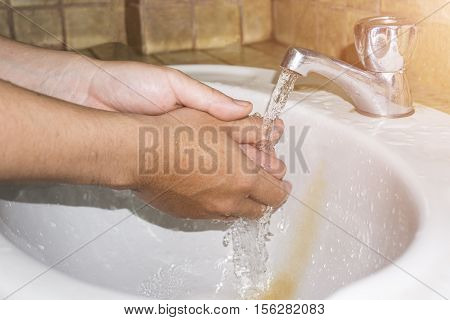 Boy Washes Hands With Running Water