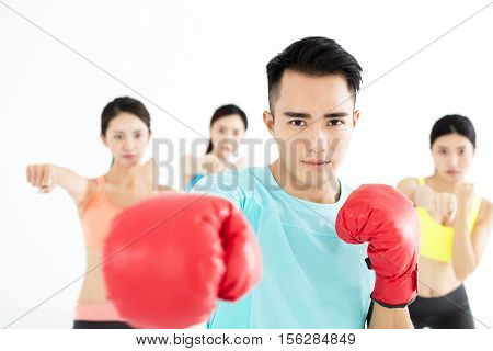young asain group people in boxing class