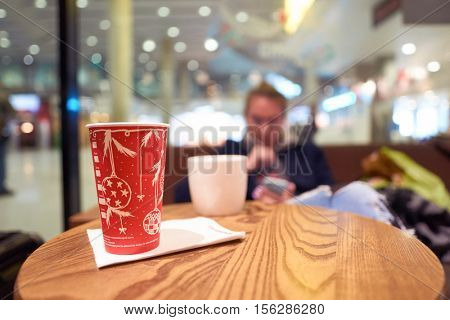 SAINT PETERSBURG, RUSSIA - 10 NOVEMBER, 2016: close up shot of a cup in Starbucks cafe. Starbucks Corporation is an American coffee company and coffeehouse chain.