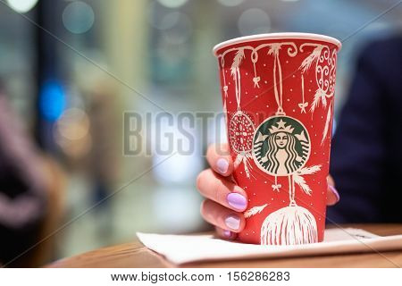 SAINT PETERSBURG, RUSSIA - 10 NOVEMBER, 2016: close up shot of a cup with Starbucks logo. Starbucks Corporation is an American coffee company and coffeehouse chain.