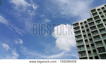 Apartment build and the background blue sky.