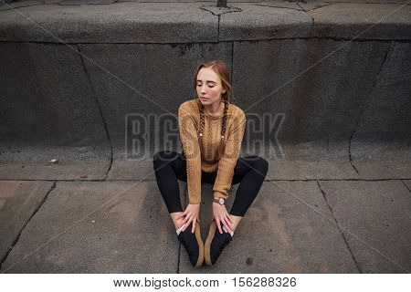 Blonde Girl Sutting On The Ground