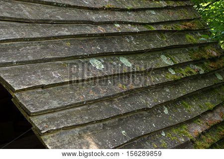 a wooden shingle on the roof of a house
